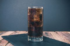 Glass of ice cold cola Royalty Free Stock Photo