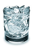 Glass of Ice Cubes. A water glass full of ice cubes isolated on a white background Stock Image