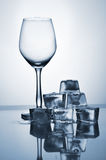 Glass and ice cubes Royalty Free Stock Image