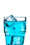 Glass with ice cubes and blue water Royalty Free Stock Image