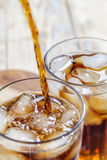 Glass with ice cubes and cola Royalty Free Stock Image
