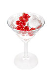 Glass with ice cubes and cranberry. royalty free stock photos