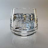 Glass and ice cubes Stock Photo