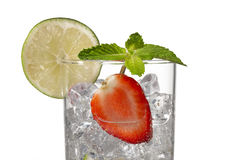 Glass with ice cubes strawberry slice and lemon slice Stock Photo