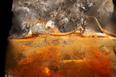 Glass with ice drink. Condensate on the surface of glass with ice drink Stock Images