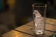 Glass with ice. Empty glass with ice on a table Stock Photos
