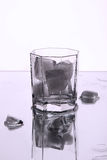 A glass with ice. Stock Photos