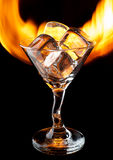 Glass with ice on fire Stock Photo