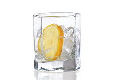 Glass with ice and fresh lemon for cocktail Stock Photography