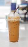 Glass of ice milk tea. Cool beverage Stock Photography