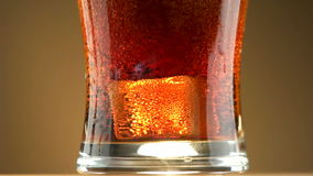 Glass ice soda cola stock footage