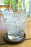 Glass of ice. On the table Royalty Free Stock Photos