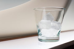 Glass with ice on the table in the club Stock Image