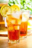 Glass of ice tea. With lemon Stock Images