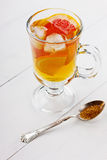 Glass of ice tea with citrus. On a light background Royalty Free Stock Image
