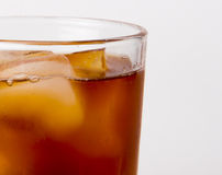 Glass with ice tea full with ice cubes. On white background Stock Images