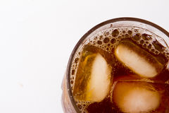 Glass with ice tea full with ice cubes. On white background Royalty Free Stock Photography