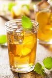 Glass of ice tea with lemon and melissa. A glass of ice tea with lemon and melissa stock photo