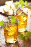 Glass of ice tea with lemon and melissa.  royalty free stock photography
