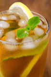 Glass of ice tea with lemon and mint close-up, selective focus Stock Photos