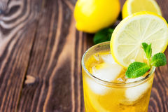Glass of ice tea with lemons Stock Photo