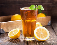 Glass of ice tea with mint and lemon Royalty Free Stock Images