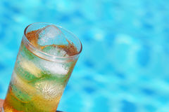 A glass of ice tea at pool with vintage filter background Stock Photos