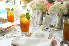 Glass of ice tea on a sun drenched table Royalty Free Stock Photo
