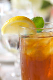 Glass of ice tea on a sun drenched table Royalty Free Stock Image