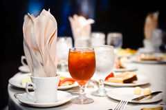 Glass of ice tea and water. A glass of ice tea and water served at the dinner table Stock Image
