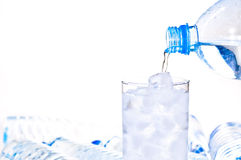 Glass of ice water being filled Royalty Free Stock Photography