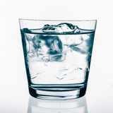 Glass with ice and water Stock Photos