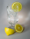 Glass of Ice Water with Lemons. Sparkling clear water with ice cubes and lemons Stock Image