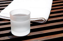 Glass of ice water at resort. Glass of ice water and a towel at resort Royalty Free Stock Photography