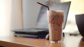 Iced chocolate on table. A glass of iced chocolate on table stock image