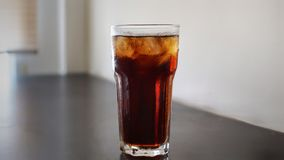Glass of iced cola. A glass of iced cola stock photo