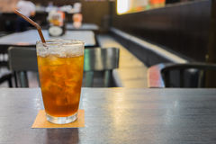 Glass of iced lemon tea on table Stock Photo