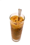 A glass of iced milk coffee. On white background royalty free stock photography