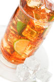 Glass of iced tea. With ice cubes, lime and mint on white background stock photo