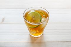 Glass of iced tea. Glass of iced tea with lime slices royalty free stock photos