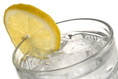 Glass of Iced Water. Closeup image of a glass of iced water with a lemon slice stock photo
