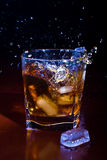 Glass of iced whisky royalty free stock photos