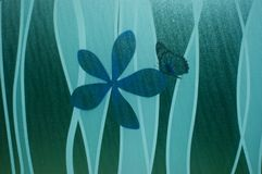 Glass icon with flower and butterfly. Blue green icon glass with paitntings Royalty Free Stock Images