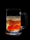 Glass illuminated pint of beer with bubbles. Isolated on black, clipping path included royalty free stock photography