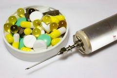 Glass injektionsspruta för järntappning Arkivfoto