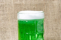 Glass of Irish green beer on a burlap background Stock Photography