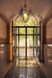 Glass italian front door with back light royalty free stock images