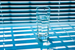 Glass with jalousie 2 Stock Photo