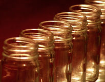 Glass Jar. S lined up in a row Royalty Free Stock Photos