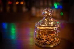 Glass jar with anise inside. Additive for tea Royalty Free Stock Image